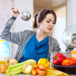 Stock Photo: Womcooking veggie lunch with laddle