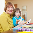 Grandmother and child drawing with  pencils   — Stock Photo