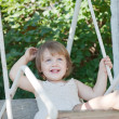 Stock Photo: Laughing girl on swing