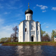 Church of Intercession on River Nerl in flood — Stock Photo #27493589