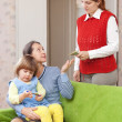 Stock Photo: Womhires babysitter for her child
