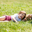 Happy   child playing with puppy at  meadow in summer — Stockfoto