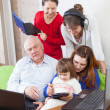 Happy  family uses few  electronic devices — Stock Photo