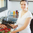 Housewife with raw seafood — Stock Photo #27494121