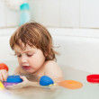 Stock Photo: 2 years baby bathes in bath