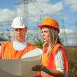 two workers at electrical power station. — Stock Photo