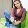 Stock Photo: Girl cares for toenails