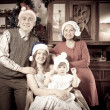 Antique photo of happy family in Santa hat — Stock Photo