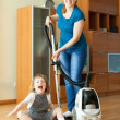 Stok fotoğraf: Family chores with vacuum cleaner