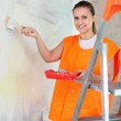 House painter paints wall — Stock Photo