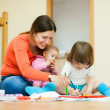 Stock Photo: Mother and children drawing on paper