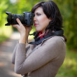 Photographer takes photo outdoor — Foto de Stock