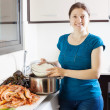 Happy woman cooking paella — Stock Photo