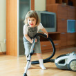 Baby girl with vacuum cleaner — Stock Photo