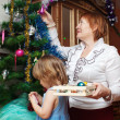 Grandmother  and baby preparing for  Christma — Stock Photo