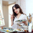 Young woman paints home of dreams — Stock Photo