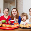 Happy three generations family drinks tea — Stock Photo
