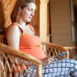 Stock Photo: Pregnant womreads e-book