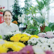 Happy mature woman in  flower shop — Photo