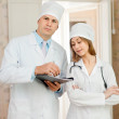 Stock Photo: Portrait of doctor and nurse