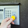 Uses intercom in door — Stock Photo #27494917