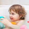 Stock Photo: Two-year kid bathes with toys