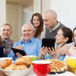Stock Photo: Happy family or friends with electronic devices