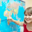 Woman showing something on world map  — Foto de Stock