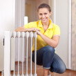 Happy woman near oil heater — Stock Photo