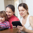 family of three generations  looks  devices  — Foto Stock