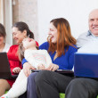 Stock Photo: Happy family uses few devices