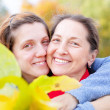 Woman with adult daughter in autumn — Stock Photo