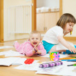Stock Photo: Cheerful sibling plays with pencils