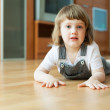 Stock Photo: Two year child on parquet