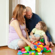 Stock Photo: Happy family in home interior