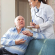Foto de Stock  : Doctor asked senior patient feels
