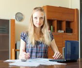 Serious woman working with financial document — Stock Photo