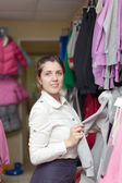 Woman chooses casual wear — Stock Photo
