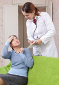 Mature woman complaining to doctor about malaise — Stock Photo