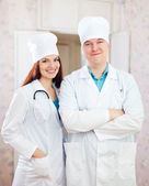 Portrait of friendly doctors in clinic — Stock Photo