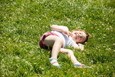 Happy child in green grass meadow — Stock Photo