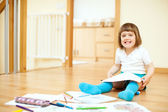 Child sketching on paper in interior — Stock Photo