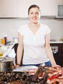 Positive woman with fresh raw sea food — Stock Photo