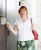 Woman opens door with electronic key — Stock Photo