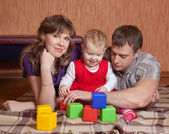 Parents and child at home — Stock Photo