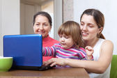 Women of three generations with netbook — Stock Photo