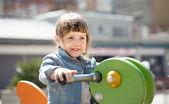 Baby girl in playground area — Stock Photo