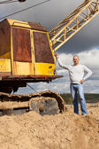 Tractor operator at sand pit — Stock Photo