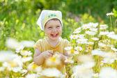 Happy girl in daisy meadow — Stock Photo