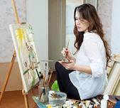 Artist paints the house on canvas — Stock Photo